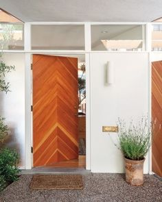 Chevron door pieced together with varying shades of Douglas fir at a mid-century modern house in California
