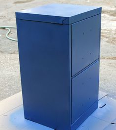 re vamp a boring file cabinet.  Wash thoroughly and sand with good sand paper.  Spray paint using a can of Krylon Dual Paint