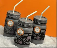 Halloween Mason jar drinks, the jars were spray painted gray and decorated with die cuts.  Or leave the jars clear and put colored juice in.  Also be cute to decorate clear plastic cups.