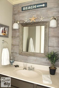 "beach theme bathroom - love the ""drift wood"" behind the half baths, beach houses, wall treatments, weathered wood, beach sign, bathroom ideas, beach bathrooms, beach themes, wood walls"