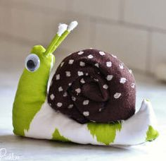 This is the cutest little snail ever! You can make this Scrappy Snail Toy in no time at all, and you only have to sew a little to make it.