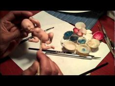 Painting a polymer clay baby - YouTube