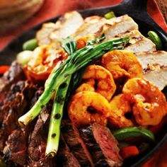 Mixed Grill Fajitas: The best of the best! Mesquite-grilled chicken breast marinated in fresh citrus & chiles, marinated and flame-grilled steak, Mexicampi Shrimp and slow-roasted carnitas.