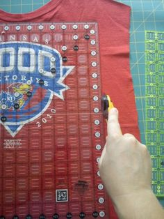 Looks like THE tutorial I need to make a T`shirt Quilt