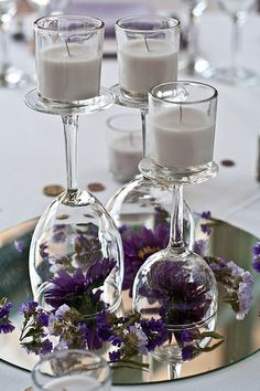 candle centerpiece, wedding ideas, candle holders, purple flowers, candles, wine glass, purple wedding, centerpieces, center piec