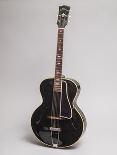 1946 Gibson L-4 black in excellent condition.  This is an unusual and very cool guitar.  We have discovered that in 1946 Gibson did a batch of long scale, maple-neck, L-4s.  We have seen 7 of these guitars in the last fifteen years all from within 50 serial numbers of each other.  This is the only black one we know of, and very possibly the only one ever made.