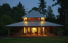 Beautiful cabin in Washington State by Rohleder Borges Architecture with a gutter-less standing seam roof made of galvanized metal. Rainwater runs down to a bed of river rock below. Think about it. via Gardenista