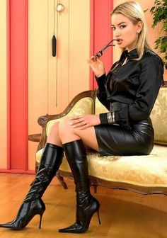 Black Leather Skirt Black Satin Blouse Sheer Pantyhose and Black Leather High Heels Boots