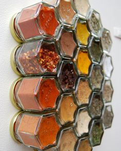 Magnetic spice jars to live on the fridge. Hexagonal jars together creating a honeycomb pattern on your fridge. Strong neodymium magnets will keep jars from sliding. Plastisol lids form an airtight lock, keeping spices fresh.