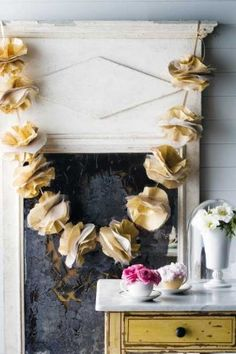 The paper garland is made from recycled paper, coffee filters, tulle and organza.