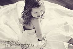 Photograph your daughter in your wedding dress when she is young, will be great to have when she gets married!