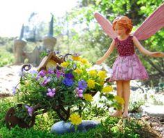 Wild Thyme fairy shows off her magical miniature fairy garden.