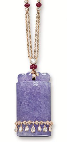 LAVENDER JADEITE, RUBY AND DIAMOND PENDANT NECKLACE The translucent lavender jadeite seal carved with a ruyi surmount, embellished by a diamond-set belt, completed by a necklace spectacle-set with circular-cut diamonds spaced by ruby rondelles, the diamonds and rubies together weighing approximately 3.50 and 12.00 carats respectively, mounted in 18 karat pink gold.