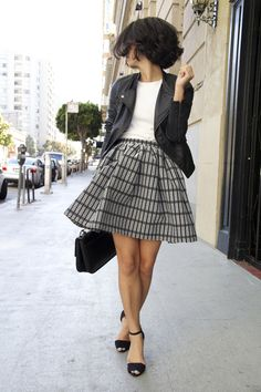 Full skirt paired with leather jacket. TopShelfClothes.com