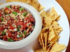 black eye pea salsa·  bag of frozen black eye peas, drained  ·2 cans Rotel tomatoes and green chilies, drained  ·1 can shoepeg corn, drained  ·1 green pepper, chopped  ·1 bunch green onions, chopped  ·Olive oil  ·Italian dressing    Directions:  Mix ingredients in a large bowl. Using a 2:1 ratio (Italian dressing to olive oil), add enough liquid to coat the vegetables. Serve with tortilla chips.