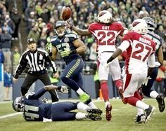 Malcolm Smith (53) watches a muffed punt fall into his hands for a touchdown, giving the Seahawks a 31-0 lead midway through a first half that had six Arizona turnovers. The Seahawks shut out Arizona for a 58-0 victory. (Photo by Dean Rutz / The Seattle Times)