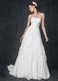 This crinkle chiffon wedding dress with lace appliques and ruffles is both elegant and fun!  Strapless A-line crinkle chiffon bodice features stunningly delicate lace applique detail.  Eye-catching ruffle skirt adds dimension and beautiful movement.  Sizes 0-14. Sweep train.  Soft White available in stores and online. White available for Special Order in stores.  Petite: Style 7WG3647  Size 0P- 14P. Special order only. Woman: Style 9WG3647  Sizes 16W- 26W.  Fully lined. Back zip.…
