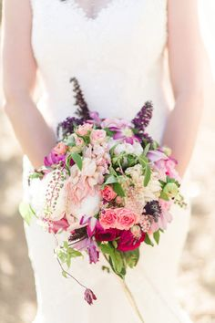 Bright floral bouquet: http://www.stylemepretty.com/2014/11/21/bright-magenta-vineyard-wedding/ | Photography: We Heart Photography - http://www.weheartphotography.com/