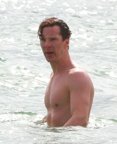 Here's a picture of Benedict Cumberbatch taking a little dip in the sea. | Benedict Cumberbatch's Long Neck Is Your New Favourite Meme