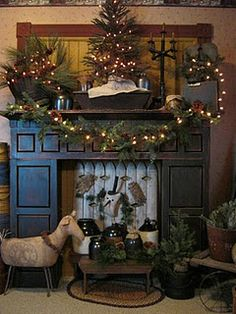 Decorated for Christmas  I so LOVE this!!  LOVE the primitive sheep by the fireplace  <3 <3 <3