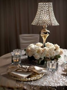 Instead of candle centerpiece a crystal lamp