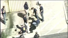 Authorities examine evidence outside the Century 16 movie theater after a mass shooting