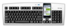 A USB keyboard with a smart phone cradle - Brilliant! (Also, why didn't anyone think of this sooner!)