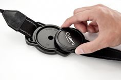 Lens cap holder that attached to your camera strap.Genius!