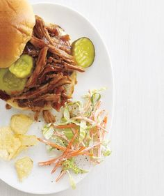 Slow-Cooker Barbecue Pork Sandwiches With Crunchy Coleslaw: You'll love these sandwiches filled with juicy, tender pork seasoned with brown sugar and chili powder.