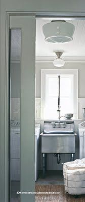 laundry room | industrial sink and schoolhouse lighting
