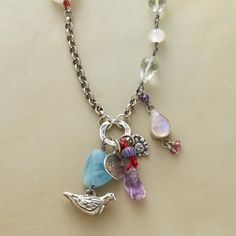 "NATURE'S GRACE NECKLACE -- An oxidized sterling silver chain bestows grace, with moonstones, aquamarine, amethyst, prehnite, pink tourmaline and a cultured pearl, plus sterling silver dove and ""Grow Strong"" tree charms. By Jes MaHarry. USA. Exclusive. 25""L."