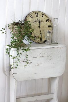 Chippy white table, old clock and greenery - Sweet!