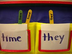 Students take a popscicle stick with a sight word and sort them into the correct pockets on the pocket chart - GENIUS