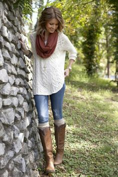 white sweater, skinny jeans, tall boots, scarf.