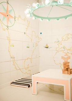 map mural and pink table