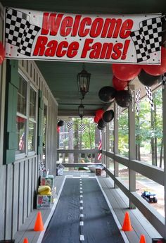 """Race Car Themed Birthday Party - The """"track"""" wasn't as long as this one, but the kids loved it!"""