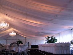 Sandra @ ribbonsandfavors.com A full ceiling drape changes any ceiling into beautiful.