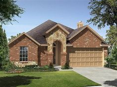 A soaring stone and brick arch frames the entry to this 4 bedroom, 2 bath home with 1,864 square feet. The Brenham Model from $143,240 by Ryland Homes in Cypress, TX.