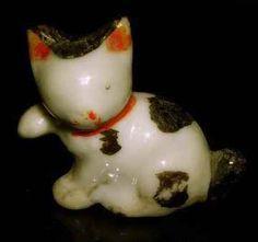 """Maneki Neko - Seto - Painted Porcelain. Circa Mid-19th Century. Unusual """"Sideways"""" Maneki Neko."""