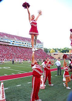 Patience Beard does a stunt at an Arkansas football game. Arkansas cheerleader cheers with a prosthetic leg after losing her leg to a disease in her childhood! What an incredible, inspirational girl!! Shows you the only limitations you have, are the limitations you put on yourself.