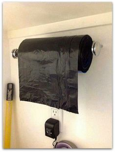 garbage bag on a paper towel roll - seriously.... why didn't I know about this before?