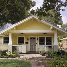remodel in Austin, TX with new front porch, paint job and drought-tolerant landscaping:  love the proportions of the porch, and the white beam and columns against the yellow.