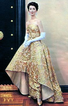 Dovima.1960 by 50'sfan, via Flickr 50s fashion style color photo print ad model magazine evening gown couture strapless column dress gold tan embroidered 60s vintage