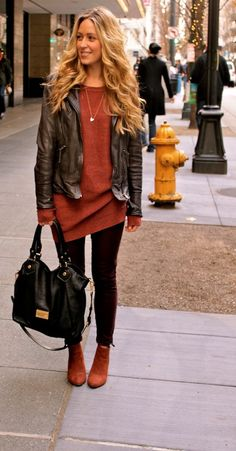 comfy and cozy fall casual style: a leather coat, a baggy asymmetrical sweater, leggings, and booties browns and burnt orange