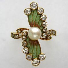 An Art Nouveau enamel, pearl and diamond ring, circa 1890