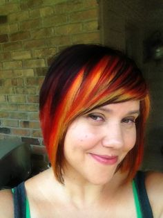 Dark hair with red, orange, and yellow panels.