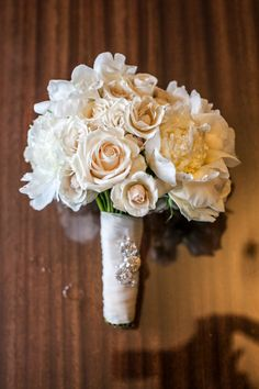 Elegant white bouquet: http://www.stylemepretty.com/michigan-weddings/2014/05/09/traditional-elegance-at-the-royal-park-hotel/ | Photography: The Shooting Gallery - http://theshootinggallery.com/