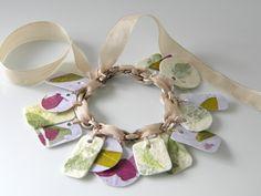 Paper and mod podge charm bracelet