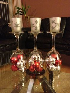 DIY Upside down wine glasses with small Christmas ornaments and candles.