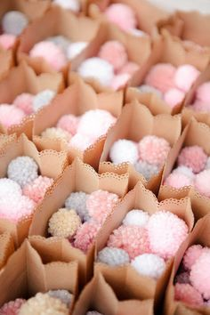Instead of confetti - DIY pom-poms, or connect to bobbles for party favours!